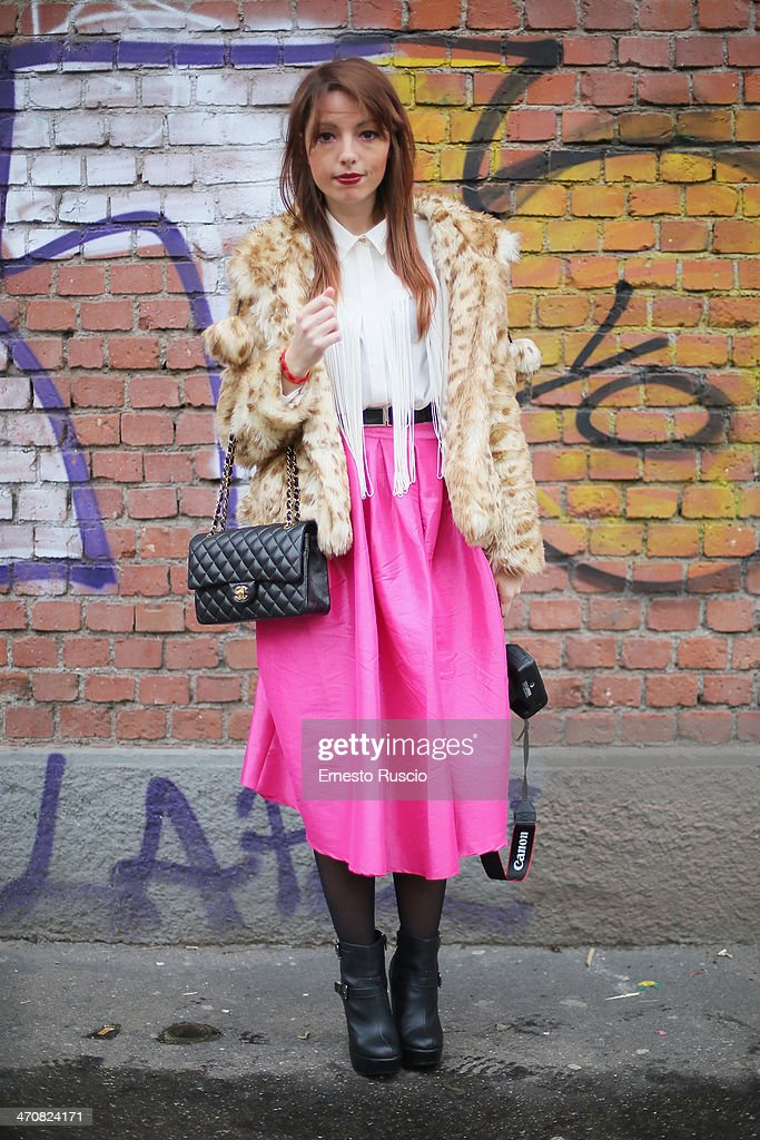 Elisa Bellino wears ASUS fur, Chanel bag and New look shoes outside the Fendi Fashion Show on day 2 of Milan Fashion Week Womenswear Autumn/Winter 2014 on February 20, 2014 in Milan, Italy.