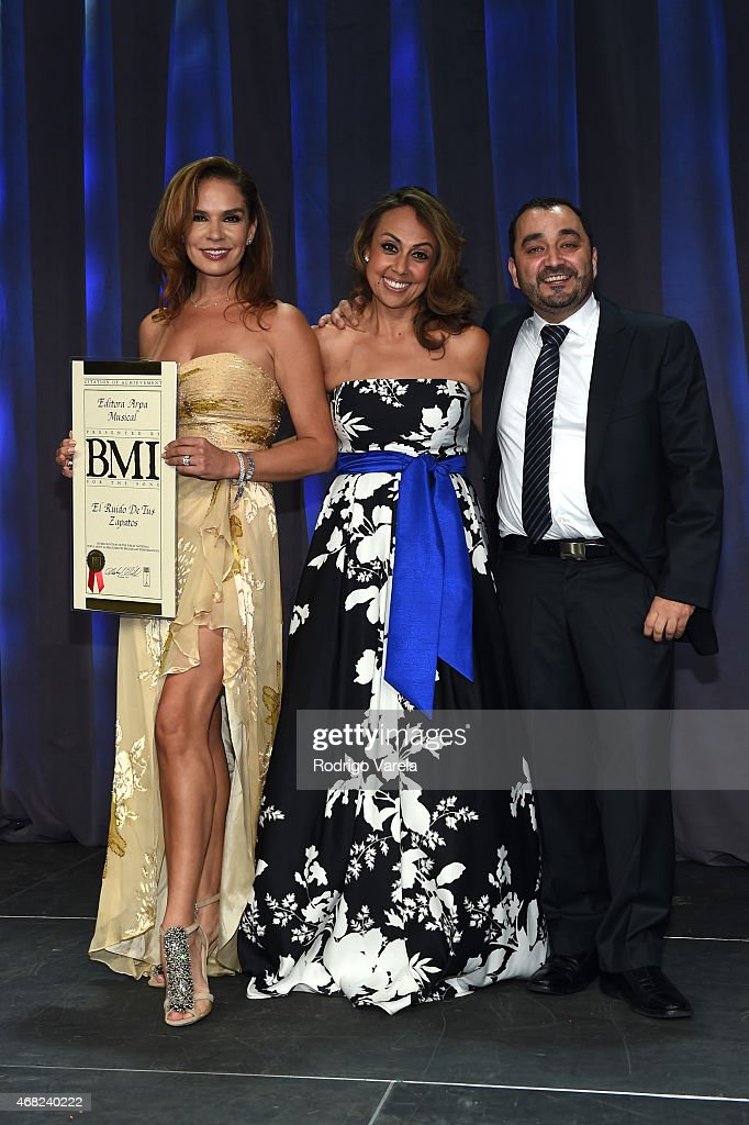 Elisa Beristain, BMI Vice President, Latin Writer/Publisher Relations Delia Orjuela, and Pepe Garza onstage at BMI's 22nd Annual Latin Music Awards at Fountainbleau Miami Beach on March 31, 2015 in Miami Beach, Florida.