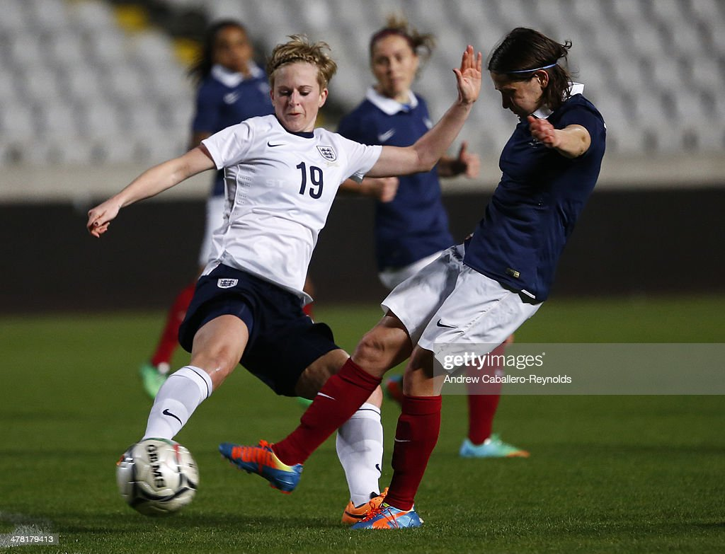 Elisa Bussaglia (R) of France and Natasha Dowie of England in action during the Cyprus cup final between England an France at GSP stadium on March 12, 2014 in Nicosia, Cyprus.