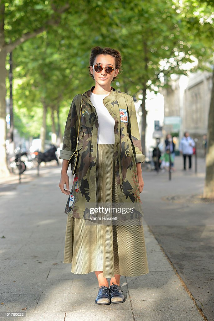 Elisa Carassai poses wearing a vintage jacket, Gap shirt, Samuji skirt, Officine Creative shoes and Emporio Armani sunglasses before Atelier Versace show on July 6, 2014 in Paris, France.