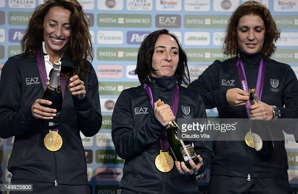 Elisa Di Francisca Ilaria Salvatori and Arianna Errigo celebrate after winning gold medal in the Women's Foil Team Fencing at The Queen Elizabeth II...