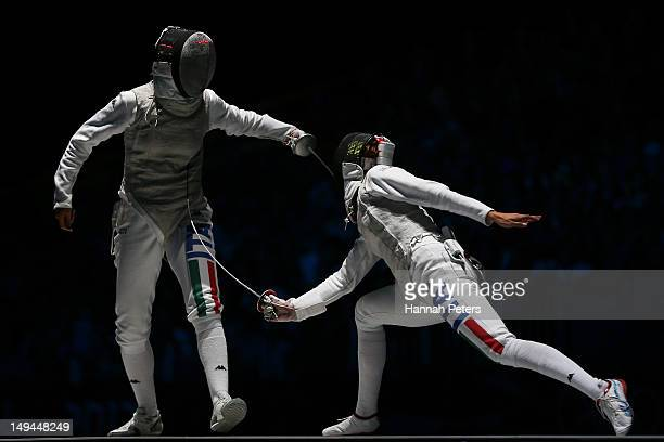Elisa Di Francisca of Italy and Arianna Errigo of Italy compete in the gold medal in her Women's Foil Individual Fencing Final match on day one of...