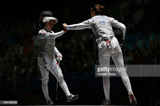 Elisa Di Francisca of Italy and Arianna Errigo of Italy compete in the gold medal in her Women's Foil Individual Fencing Semi Final match on day one...