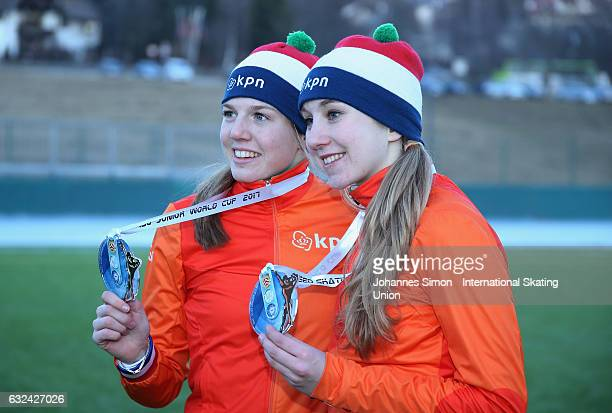 Elisa Dul and Sanne in 't Hof of the Netherlands pose with their medals after winning the women's junior mass start draw for the ISU junior world cup...