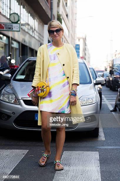 Elisa Nalin wears a pale yellow jacket during the Milan Fashion Week Spring/Summer 16 on September 26 2015 in Milan Italy