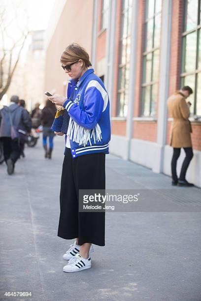 Elisa Nalin wears Adidas superstar sneakers on February 26 2015 in Milan Italy