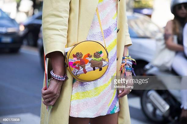 Elisa Nalin's yellow details purse and bracelets during the Milan Fashion Week Spring/Summer 16 on September 26 2015 in Milan Italy