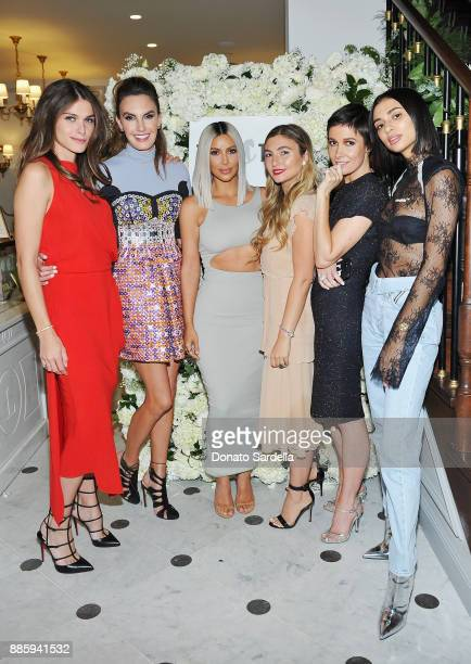 Elisa Sednaoui Dellal Elizabeth Chambers Hammer Kim Kardashian West Nasiba Adilova Cassandra Grey and Kristen Noel Crawley attend The Tot holiday...