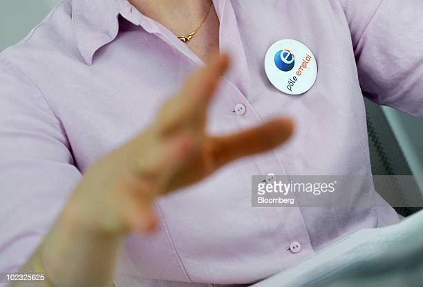Elisabet Rebour a Pole Emploi employee gestures while assisting a jobseeker at an unemployment office in Boulogne near Paris France on Wednesday June...