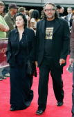 Elisabeth Findlay and Neville Findlay fashion designers of the label Zambesi make their way up the red carpet at the Auckland premiere of 'North...