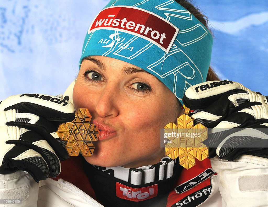 Elisabeth Goergl of Austria celebrates with her two gold medals for winning Women's Super G and Downhill after finishing first in the Women's Downhill during the Alpine FIS Ski World Championships on the Kandahar course on February 13, 2011 in Garmisch-Partenkirchen, Germany.