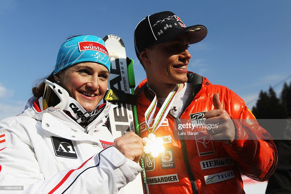 Elisabeth Goergl of Austria celebrates with Men's Downhill champion Erik Guay of Canada after winning the Women's Downhill during the Alpine FIS Ski World Championships on the Kandahar course on February 13, 2011 in Garmisch-Partenkirchen, Germany.