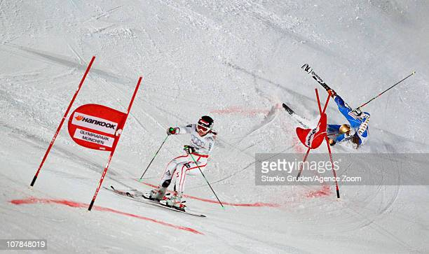 Elisabeth Goergl of Austria takes 3rd place and Maria PietilaeHolmner of Sweden takes 1st place during the Audi FIS Alpine Ski World Cup Men's and...