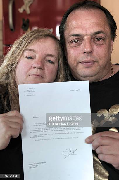 Elisabeth Lorentz and Eric Holder pose on June 7 2013 in Dabo eastern France a day after they received a letter from the French Presidency Eric and...