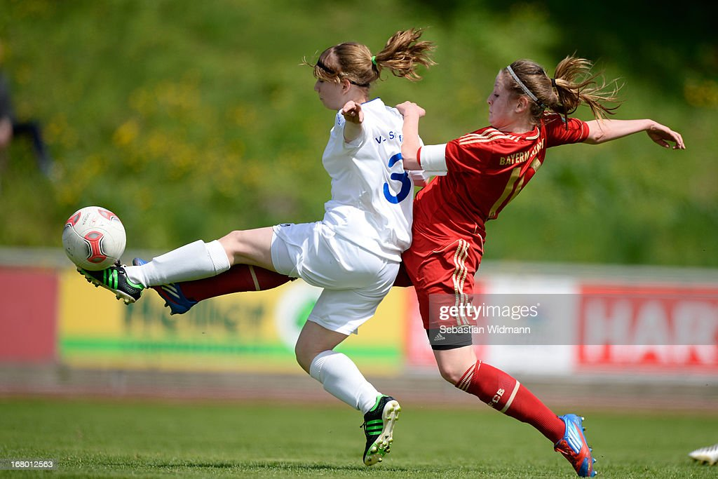 Elisabeth Mayr of Muenchen challenges Bianca Broesamle of Sindelfingen during the B Junior Girls match between Bayern Muenchen and VfL Sindelfingen at Sportpark Aschheim on May 4, 2013 in Aschheim, Germany.