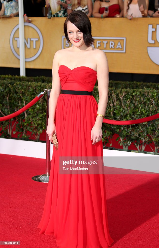<a gi-track='captionPersonalityLinkClicked' href=/galleries/search?phrase=Elisabeth+Moss&family=editorial&specificpeople=3079265 ng-click='$event.stopPropagation()'>Elisabeth Moss</a> arrives at the 20th Annual Screen Actors Guild Awards at the Shrine Auditorium on January 18, 2014 in Los Angeles, California.
