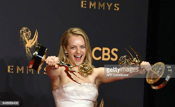 TOPSHOT Elisabeth Moss poses with the awards for Outstanding Drama Series and Outstanding Lead Actress in a Drama Series for 'The Handmaid's Tale'...