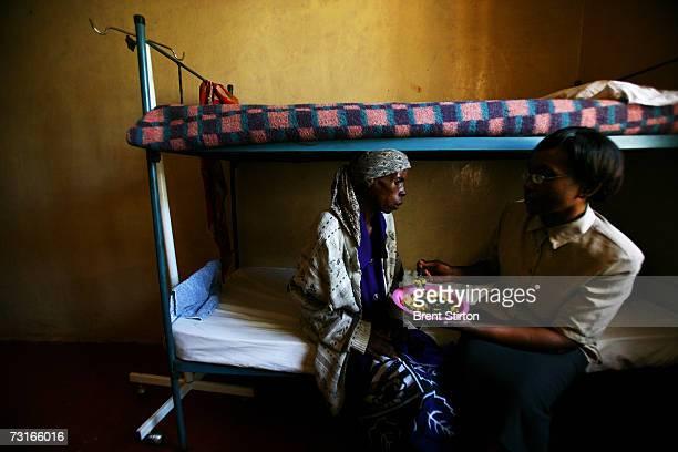 Elisabeth Mweru feeding herself again for the first time in weeks as she recovers from severe tuberculosis November 28 2006 in Meru Kenya Elizabeth...