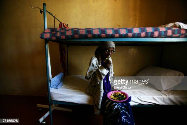 Elisabeth Mweru feeding herself again for the first time in weeks as she recovers from severe tuberculosis November 28 2006 in Meru Kenya Elizabeth...