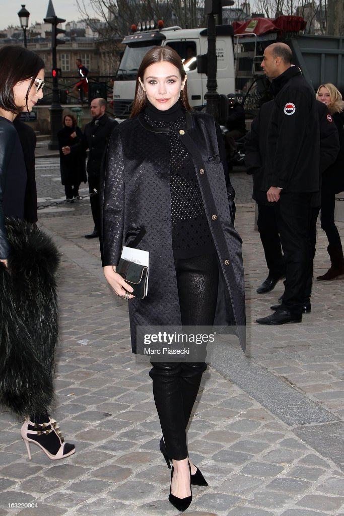 Elisabeth Olsen arrives to attend the 'Louis Vuitton' Fall/Winter 2013 Ready-to-Wear show as part of Paris Fashion Week on March 6, 2013 in Paris, France.