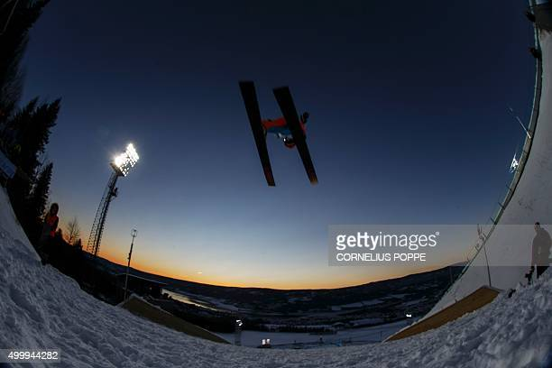 Elisabeth Raudaschl of Austria flies into the sunset as she competes in the Ladies' HS100 ski jumping World Cup competition in Lillehammer Norway on...