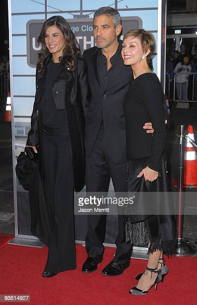 Elisabetta Canalis actor George Clooney and his mother Nina Warren Clooney arrive at the premiere of Paramount Pictures' 'Up In The Air' held at Mann...