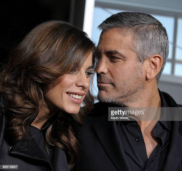 Elisabetta Canalis and actor George Clooney arrive at the premiere of Paramount Pictures' 'Up In The Air' held at Mann Village Theatre on November 30...