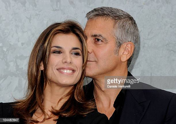 Elisabetta Canalis and George Clooney attend the Giorgio Armani Spring/Summer 2011 fashion show during Milan Fashion Week Womenswear on September 27...