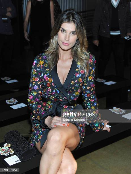Elisabetta Canalis attends Moschino Spring/Summer 18 Menswear and Women's Resort Collection at Milk Studios on June 8 2017 in Hollywood California