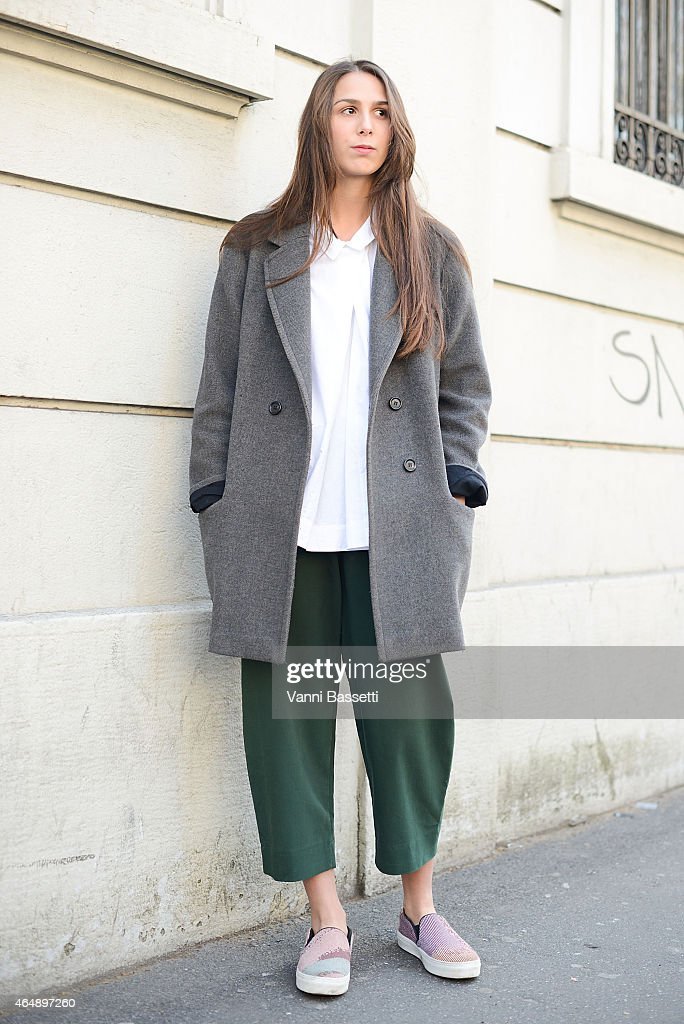 Elisabetta Di Maso poses wearing Isabel Marant X H and M coat Cos shirt and pants and Celine shoes on March 1 2015 in Milan Italy