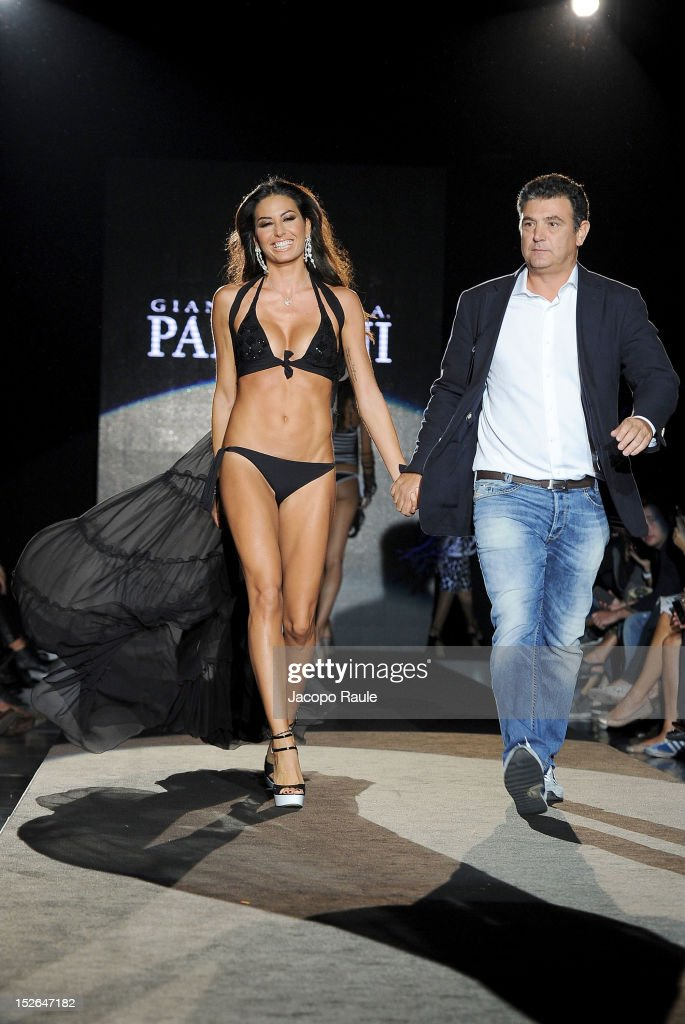 <a gi-track='captionPersonalityLinkClicked' href=/galleries/search?phrase=Elisabetta+Gregoraci&family=editorial&specificpeople=606805 ng-click='$event.stopPropagation()'>Elisabetta Gregoraci</a> and Andrea Paladini walks the runway at the Gianantonio A. Paladini Spring/Summer 2013 fashion show as part of Milan Womenswear Fashion Week on September 23, 2012 in Milan, Italy.