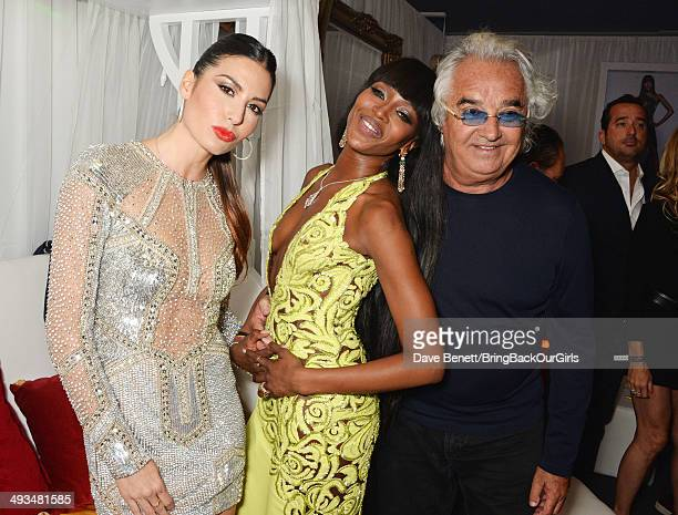 Elisabetta Gregoraci Naomi Campbell and Flavio Briatore attend Naomi Campbell's birthday party at the Billionaire Club Sunset Lounge on May 23 2014...