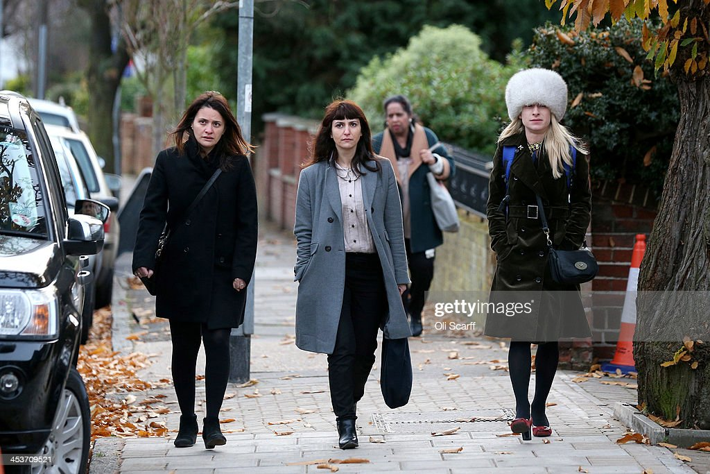 Elisabetta Grillo (L) and Francesca Grillo (C) arrive at Isleworth Crown Court on December 5, 2013 in London, England. The Italian sisters, who worked as assistants to Nigella Lawson and Charles Saatchi, are accused of defrauding them of over 300,000 GBP.