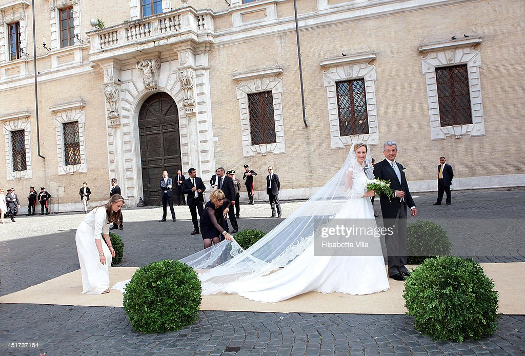 Elisabetta Maria Rosboch von Wolkenstein and her father Ettore Rosboch von Wolkenstein arrive for her wedding to Prince Amedeo of Belgium at Basilica Santa Maria in Trastevere on July 5, 2014 in Rome, Italy.