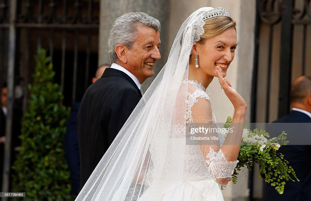 Elisabetta Maria Rosboch von Wolkenstein with her father Ettore Rosboch von Wolkenstein arrives for her wedding to Prince Amedeo of Belgium at Basilica Santa Maria in Trastevere on July 5, 2014 in Rome, Italy.