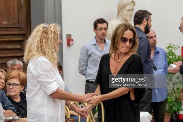 Elisabetta the daughter of Paolo Villaggio with Maria Sole Tognazzi in front the coffin of Italian actor Paolo Villaggio lying in repose at Rome's...