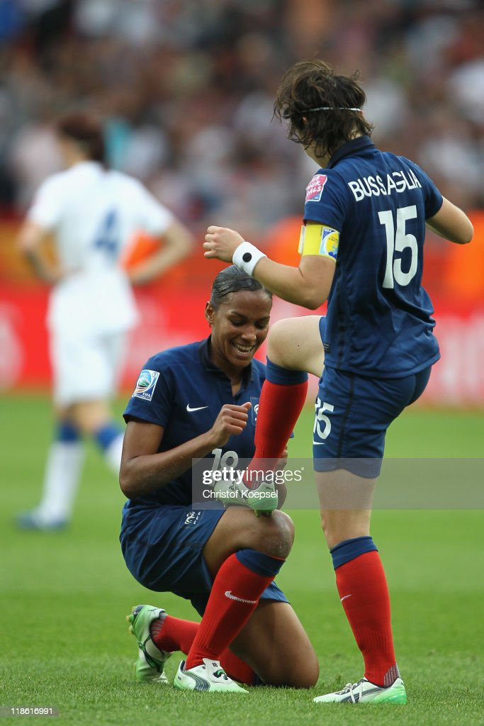 <a gi-track='captionPersonalityLinkClicked' href=/galleries/search?phrase=Elise+Bussaglia&family=editorial&specificpeople=2359308 ng-click='$event.stopPropagation()'>Elise Bussaglia</a> of France (R) celebrates the first goal with <a gi-track='captionPersonalityLinkClicked' href=/galleries/search?phrase=Marie-Laure+Delie&family=editorial&specificpeople=7890953 ng-click='$event.stopPropagation()'>Marie-Laure Delie</a> of France (L) during the FIFA Women's World Cup 2011 Quarter Final match between England and France at the FIFA Women's World Cup Stadium Leverkusen on July 9, 2011 in Leverkusen, Germany.