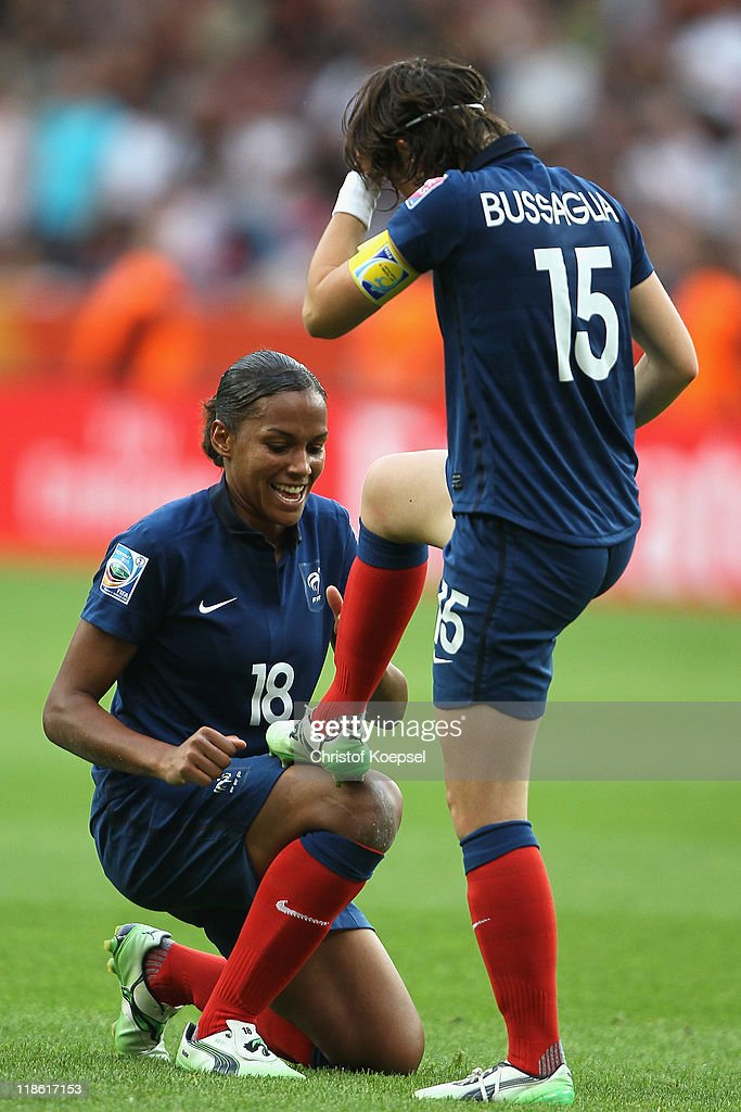 Elise Bussaglia of France (R) celebrates the first goal with Marie-Laure Delie of France (L) during the FIFA Women's World Cup 2011 Quarter Final match between England and France at the FIFA Women's World Cup Stadium Leverkusen on July 9, 2011 in Leverkusen, Germany.