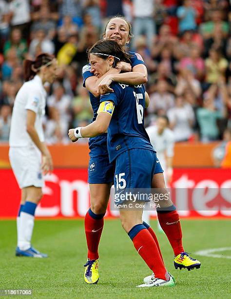 Elise Bussaglia of France celebrates with Gaetane Thiney after Bussaglia scored the equalizer against England during the FIFA Women's World Cup 2011...