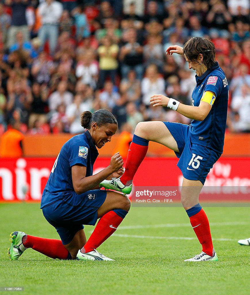 <a gi-track='captionPersonalityLinkClicked' href=/galleries/search?phrase=Elise+Bussaglia&family=editorial&specificpeople=2359308 ng-click='$event.stopPropagation()'>Elise Bussaglia</a> of France celebrates with <a gi-track='captionPersonalityLinkClicked' href=/galleries/search?phrase=Marie-Laure+Delie&family=editorial&specificpeople=7890953 ng-click='$event.stopPropagation()'>Marie-Laure Delie</a> after Bussaglia scored the equalizer against England during the FIFA Women's World Cup 2011 Quarter Final match between England and France at the FIFA Women's World Cup Stadium Leverkusen on July 9, 2011 in Leverkusen, Germany.
