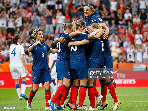 Elise Bussaglia of France celebrates with teammates after she scored the equalizer against England during the FIFA Women's World Cup 2011 Quarter...