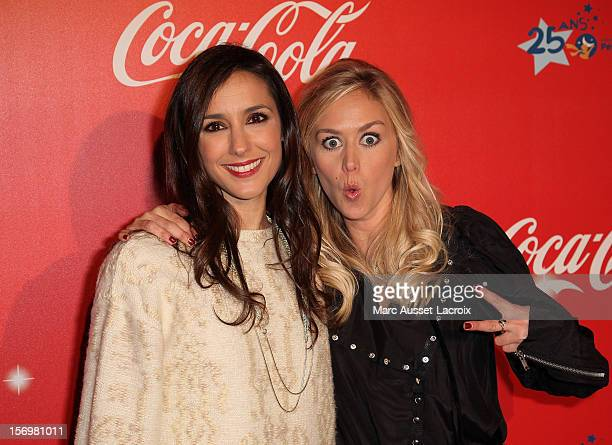 Elise Chassaing and Enora Malagre poses at the Coca Cola Christmas windows inauguration at Le Showcase on November 26 2012 in Paris France