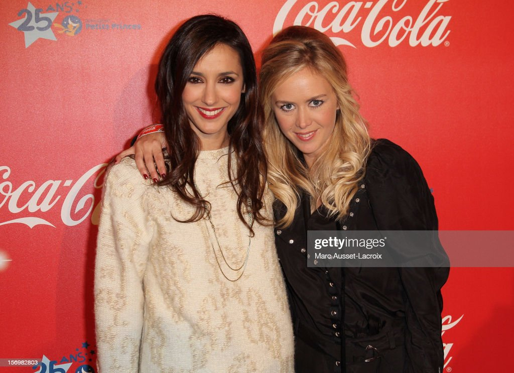 Elise Chassaing and Enora Malagre poses at the Coca Cola Christmas windows inauguration at Le Showcase on November 26, 2012 in Paris, France.