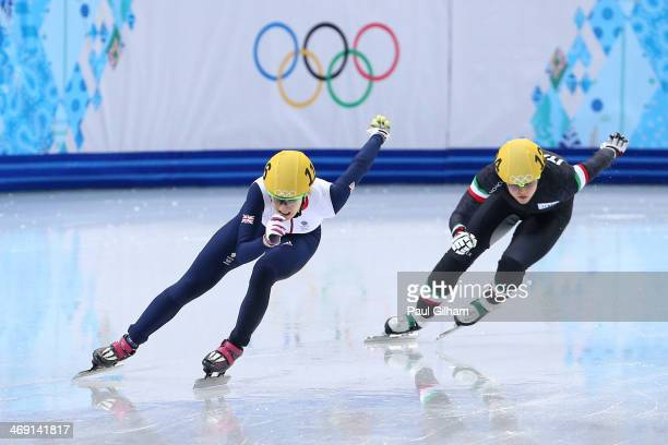 Elise Christie of Great Britain and Arianna Fontana of Italy compete in the Short Track Speed Skating Ladies' 500 m Final on day 6 of the Sochi 2014...