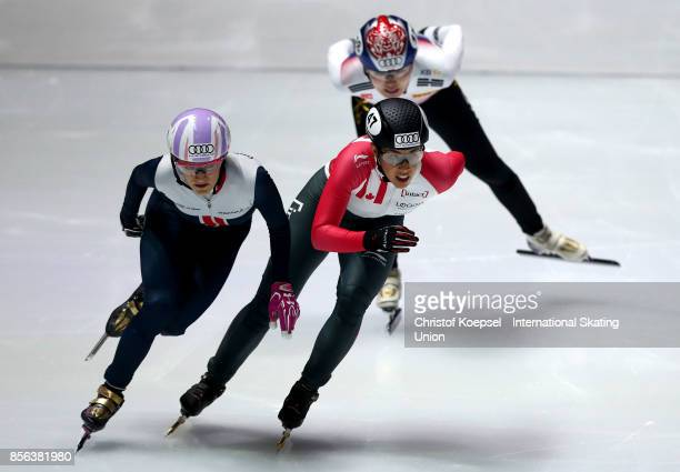 Elise Christie of Great Britain and Valerie Maltais of Canada compete during the ladies 1000m semifinal heat one during the Audi ISU World Cup Short...