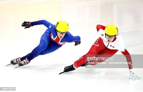 Elise Christie of Great Britain attempts to get past Marianne StGelais of Canada during the quarterfinals of the Women's 1000m race on day 1 of the...