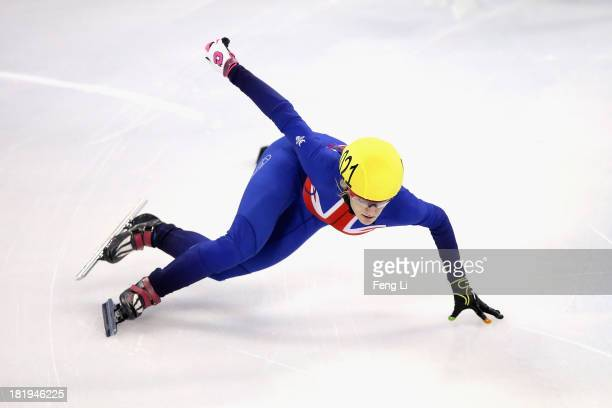 Elise Christie of Great Britain competes in the Women's 500m PrePreliminaries during day one of the 2013/14 Samsung ISU World Cup Short Track at the...