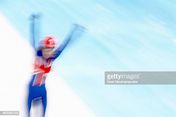 Elise Christie of Great Britain crosses the finish line and celebrates after winning the Ladies 500m final gold medal during day 2 of the ISU...