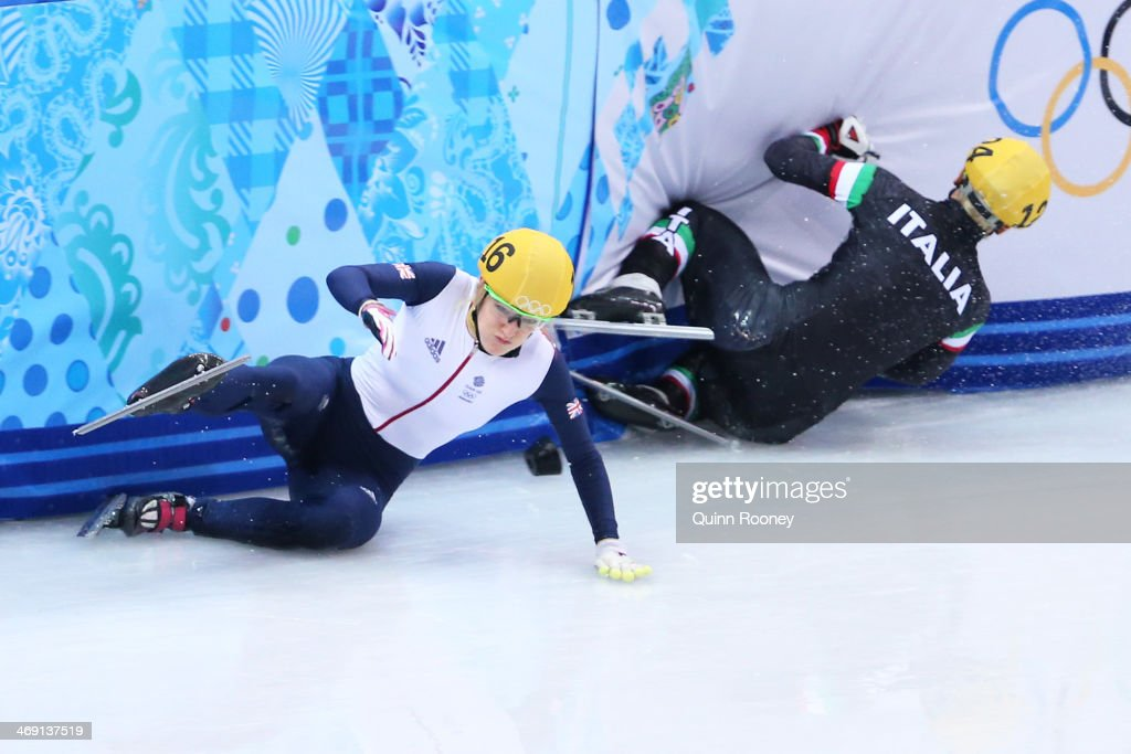<a gi-track='captionPersonalityLinkClicked' href=/galleries/search?phrase=Elise+Christie&family=editorial&specificpeople=4113885 ng-click='$event.stopPropagation()'>Elise Christie</a> of Great Britain (L) falls and collides with <a gi-track='captionPersonalityLinkClicked' href=/galleries/search?phrase=Arianna+Fontana&family=editorial&specificpeople=4680451 ng-click='$event.stopPropagation()'>Arianna Fontana</a> of Italy (R) during the Short Track Speed Skating Ladies' 500 m Final on day 6 of the Sochi 2014 Winter Olympics at at Iceberg Skating Palace on February 13, 2014 in Sochi, Russia.