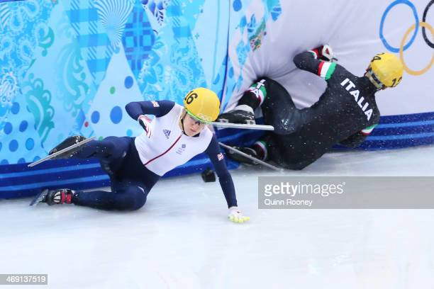 Elise Christie of Great Britain falls and collides with Arianna Fontana of Italy during the Short Track Speed Skating Ladies' 500 m Final on day 6 of...